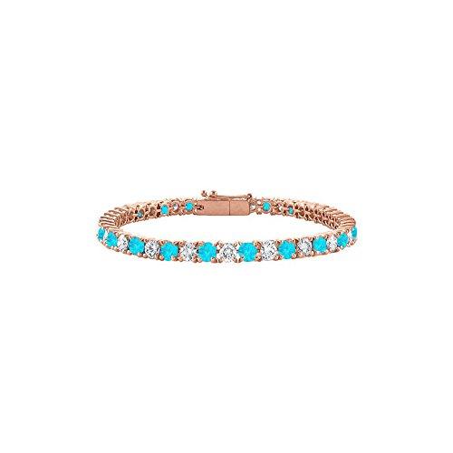 Cubic Zirconia and Created Blue Topaz Tennis Bracelet in 14K Rose Gold Vermeil. 4 CT TGW. 7 Inch