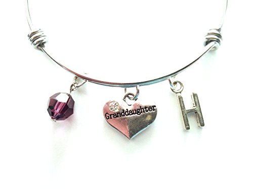 Granddaughter themed personalized bangle bracelet. Antique silver charms and a genuine Swarovski birthstone colored element.