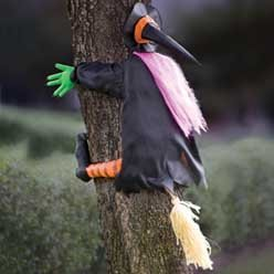 Betty Bash Crashing Witch Into Tree Halloween Decoration