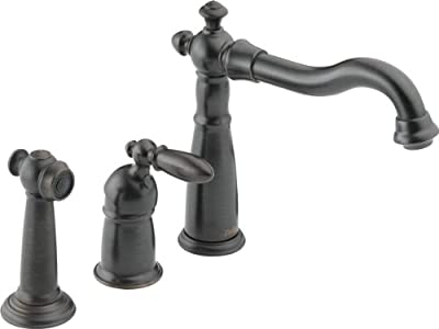 Victorian Three Hole Single Handle Kitchen Faucet with Spray by Delta