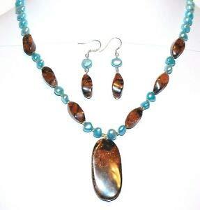 GN390 Bronze Black Swirl Goldstone & Blue Pearl w Silver 18
