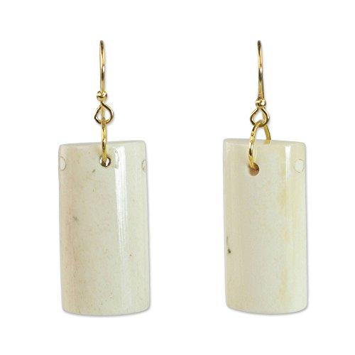 - NOVICA Brass Cow Bone Dangle Earrings 'Afterglow'