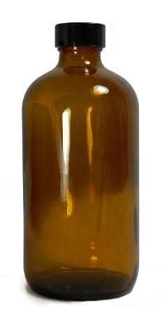 Qorpak Amber Glass Boston Round Bottle with Black Phenolic Polyseal Cone Lined Cap