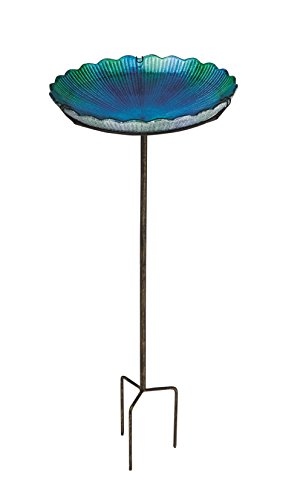 Blue, glass bird bath with a metal stand.