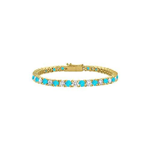 CZ and Created Blue Topaz Tennis Bracelet in 18K Yellow Gold Vermeil. 4CT. TGW. 7 Inch