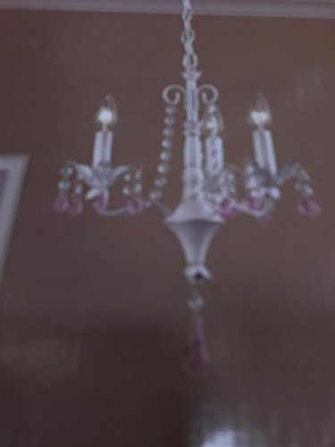Antiqued white finish chandelier • Faux candlestick lights and dangling crystal accents