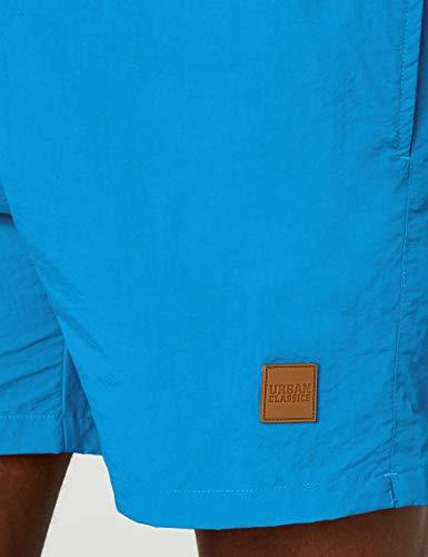 31jaEoln WL El imprescindible para el baño: gracias a su look casual, su cintura elástica y su color liso neutro, este bañador promete comodidad y versatilidad, sin renunciar al estilo moderno. El Must-Have: gracias a su tejido 100% nylon, proporciona un secado rápido y puede lavarse a máquina, mientras que el calzoncillo interior de malla ofrece máximo confort. 100% Poliéster