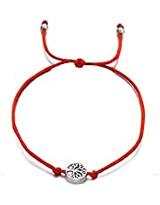 A bracelet of red thread with the tree of life