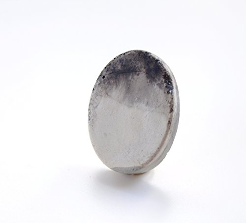 stylish-oval-brooch-pin-in-concrete-gray-and-black-stains