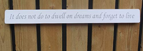 Handmade wooden sign It does not do to dwell on dreams.