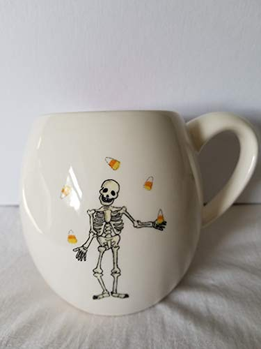 - RAE DUNN by Magenta SKELETON with Candy Corn HALLOWEEN Mug with Orange inside