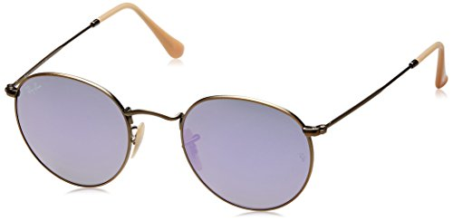 982eff77c0 Retro metal sunglasses featuring round prescription-ready lenses and protective  case  Ray-Ban ...