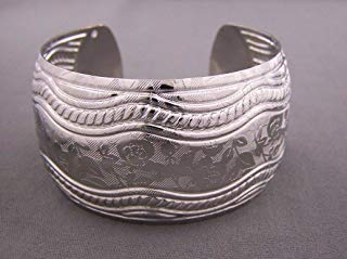 Silver tone cuff bracelet metal bangle 1.5 wide textured stamped floral pattern ()