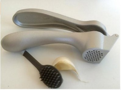 The Pampered Chef New Improved Garlic Press