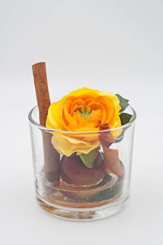 Pequeño centro de mesa con ranúnculo naranja/amarillo,manzana roja ...