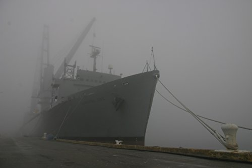 Home Comforts The Military Sealift Command auxiliary crane ship USNS Flickertail State fades into morning fog whi by Home Comforts