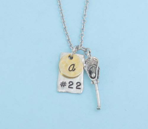 (Lacrosse charm pendant in silver pewter personalized by player's number on silver pewter blank and initial in hammered, gold plated pewter.)