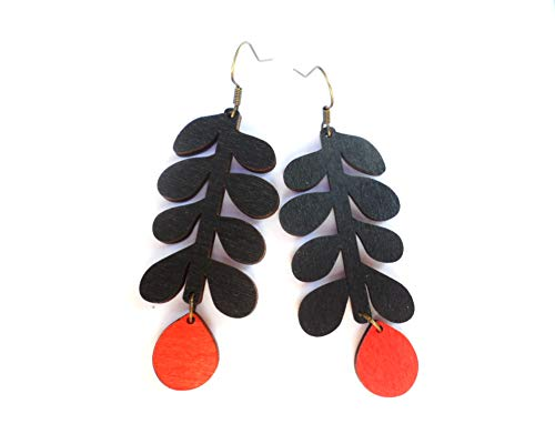 Selma Dreams Scandinavian statement earrings with large black wooden pendants and brass hooks
