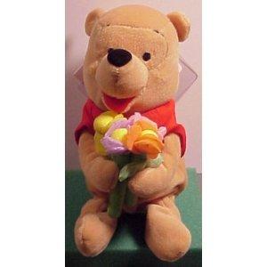 Winnie the Pooh Bean Bag Plush holding Flower Pooh ()