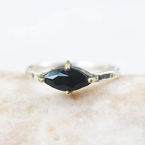 - Marquis faceted black onyx ring in silver bezel and brass prongs setting with sterling silver hammer texture band