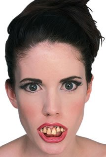 - Rubie's Costume Co Ghoul Teeth & Putty Costume