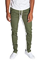 KDNK Men's Tapered Skinny Fit Stretch Drawstring Ankle Zip Striped Track Pants. Established in 1998, KDNK is one of the longest standing men's clothing manufacturers in the city of Los Angeles. Our goal is to bring you LA without the LA price...