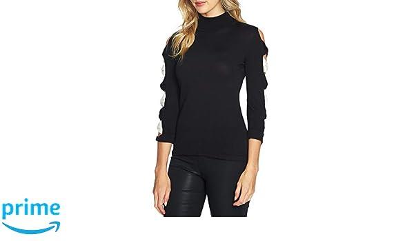 6a246e392964f CeCe Women s Mock-Neck Bow Sleeve Top Black White Medium at Amazon Women s  Clothing store