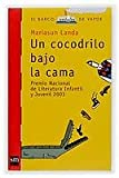Un cocodrilo bajo la cama/ A Crocodile Under the Bed (El barco de vapor: Serie Roja/ The Steamboat: Red Series) (Spanish Edition)