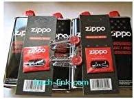 4 latas de gasolina para Zippo, 2 piedras para Zippo y 2 mechas para Zippo.