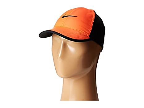 eba417c5 Image Unavailable. Image not available for. Color: Nike Featherlight Cap ...