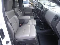 Durafit Gray Covers.2004-2008 Ford F150 XL Super Cab Exact Fit Seat Covers. Front 40/20/40 Split Seat with Integrated Seat Belts and Solid Center Armrest. Rear Solid Back 60/40 Split Bottom Bench. (Rear Center Seat Belt)