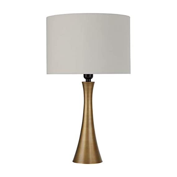 "Amazon Brand – Rivet Mid-Century Modern Needle Sloped Table Desk Lamp with Light Bulb and White Drum Shade, 21""H, Brass - A warm accessory to any room, this sleek, curved table lamp adds high style to your décor while providing pleasing light. A drum shade adds a classic touch. Contemporary style with classic touch Metal with antique brass finish - lamps, bedroom-decor, bedroom - 31vyWcd9gsL. SS570  -"