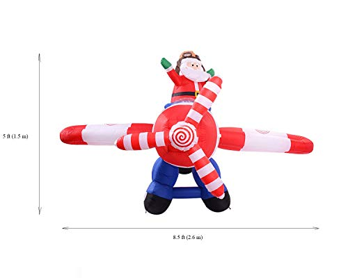 MBN 8.5 x 5 x 8 Ft Animated Santa Clause on Airplane Inflatable Decorations Indoor/Outdoor Funny Giant Christmas Figures Airblown Inflatables Xmas Blow Ups with Lights, Fan and Anchor Ropes