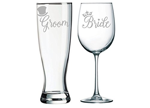 Bride and Groom Wedding glass set with tophat and crown.]()