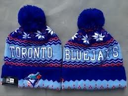 d714be55f3abb Amazon.com   Toronto Blue Jays Snowflake Beanie New Era Cuffed ...