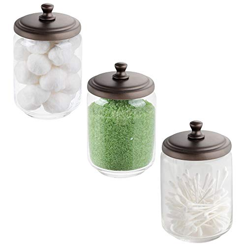 - mDesign Modern Glass Bathroom Vanity Countertop Storage Organizer Canister Apothecary Jar for Cotton Swabs, Rounds, Balls, Makeup Sponges, Blender, Bath Salts - 3 Pack - Clear/Bronze
