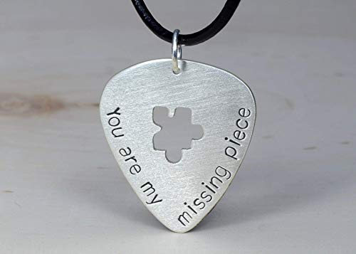 (Sterling silver guitar pick necklace with puzzle piece cut out)