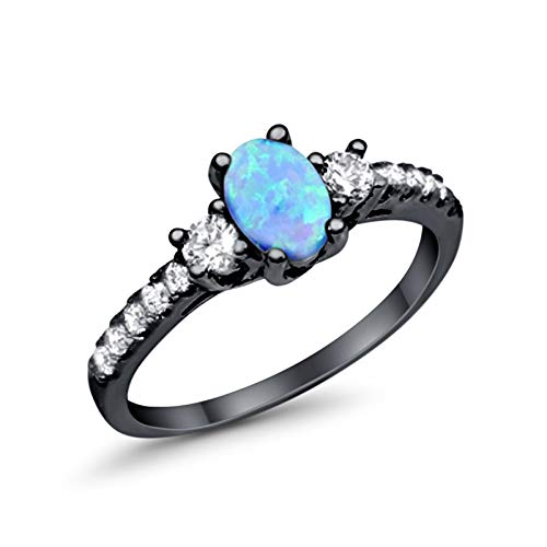- Sterling Silver Black Tone Rhodium Plated Ring Oval Cut Fire Created Blue Opal with Round Clear CZ Accent