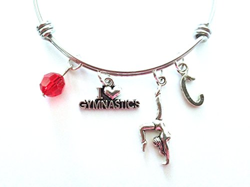 Gymnastics / Gymnast themed personalized bangle bracelet. Antique silver charms and a genuine Swarovski birthstone colored element. -