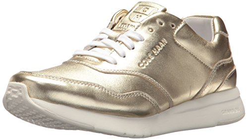 Cole Haan Women's Grandpro Runner, Metallic Soft Gold, 7.5 B US by Cole Haan