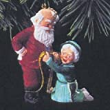 A Fitting Moment Mr. and Mrs. Claus 8th in Series 1993 Hallmark Ornament QX4202