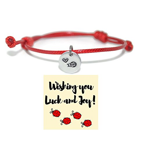 Ladybug and heart hand stamped red cord bracelet and good luck ()
