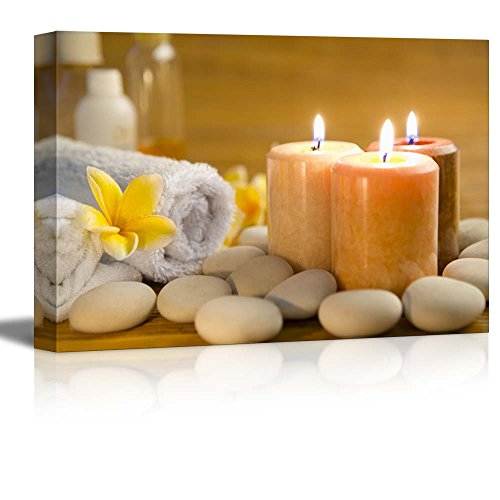 Zen Stones with Burning Candles in a Spa Wall Decor ation