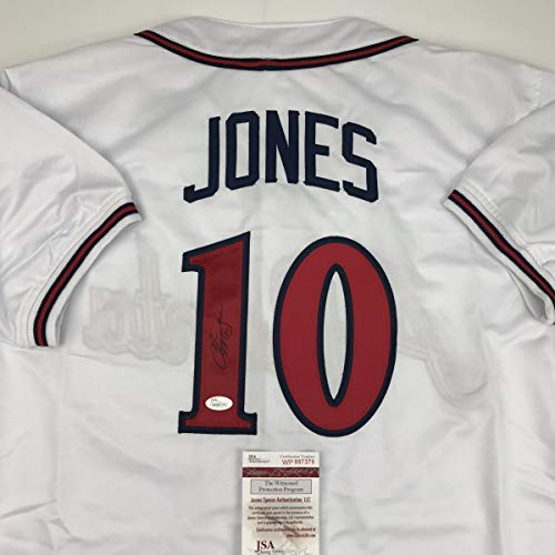 - Autographed/Signed Chipper Jones Atlanta White Baseball Jersey JSA COA