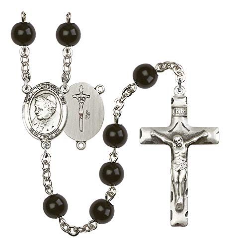 Silver Plate Rosary Features 7mm Black Onyx Beads. The Crucifix Measures 1 3/4 x 1. The Centerpiece Features a Pope Emeritace Benedict XVI Medal. Patron Saint