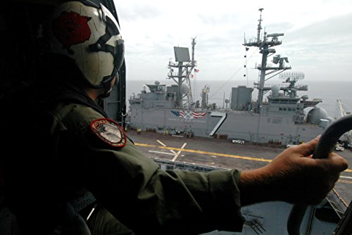 - Home Comforts An air crewman looks out the cabin door of his MH-60S Seahawk helicopter as it hovers over the