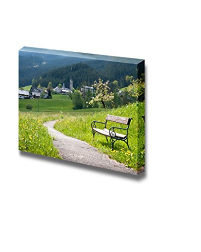 Bench and a Curved Country Road in a Rural Landscape in Springtime Wall Decor ation