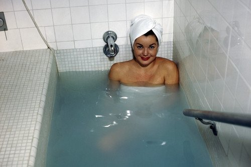 Esther Williams soaking in bath tub hair in towel vintage color ...