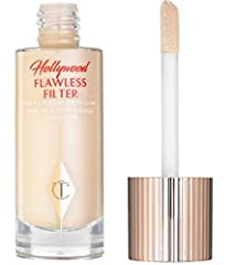 OVERVIEW Inspired by social media filters and the luminescence of celebrity skin, Charlotte Tilbury's Hollywood Flawless Filter offers a buildable primer-illuminator hybrid that stretches effortlessly across the skin. Airbrush polymers reduce...