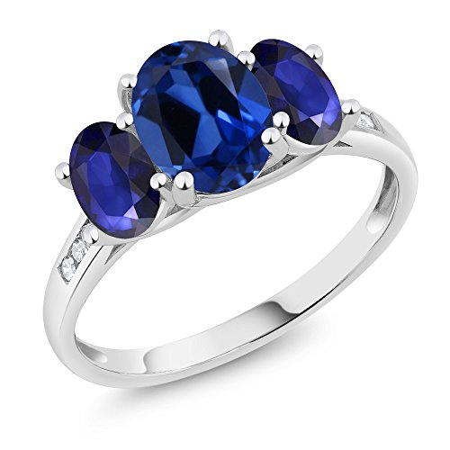 10K White Gold Diamond Accent Oval Blue Simulated Sapphire Blue Sapphire 3-Stone Ring 2.50 Ct, Available in size (5,6,7,8,9)